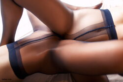 blonde girls in stockings and silk satin lingerie